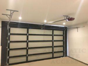 panel lift garage door opener installed on custom sectional door